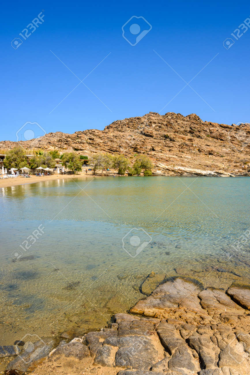 Monastiri Beach (the beach of the monastery of Agios Ioannis) located in a small rocky bay surrounded by rocky hills. Paros island, Cyclades, Greece - 169664156