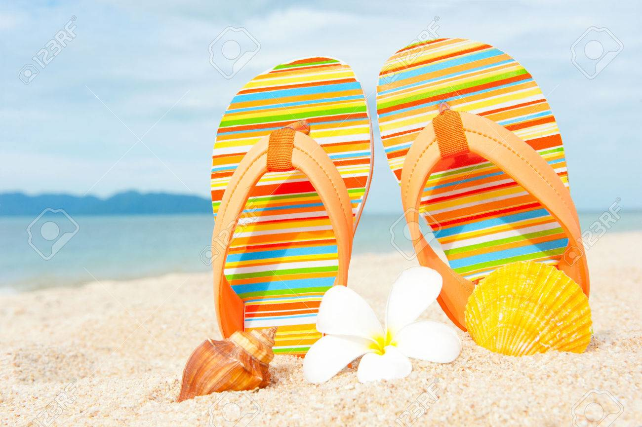 Sandals shoes holidays - Holidays Background Beach Sandals On The Sandy Coast Stock Photo 35146088