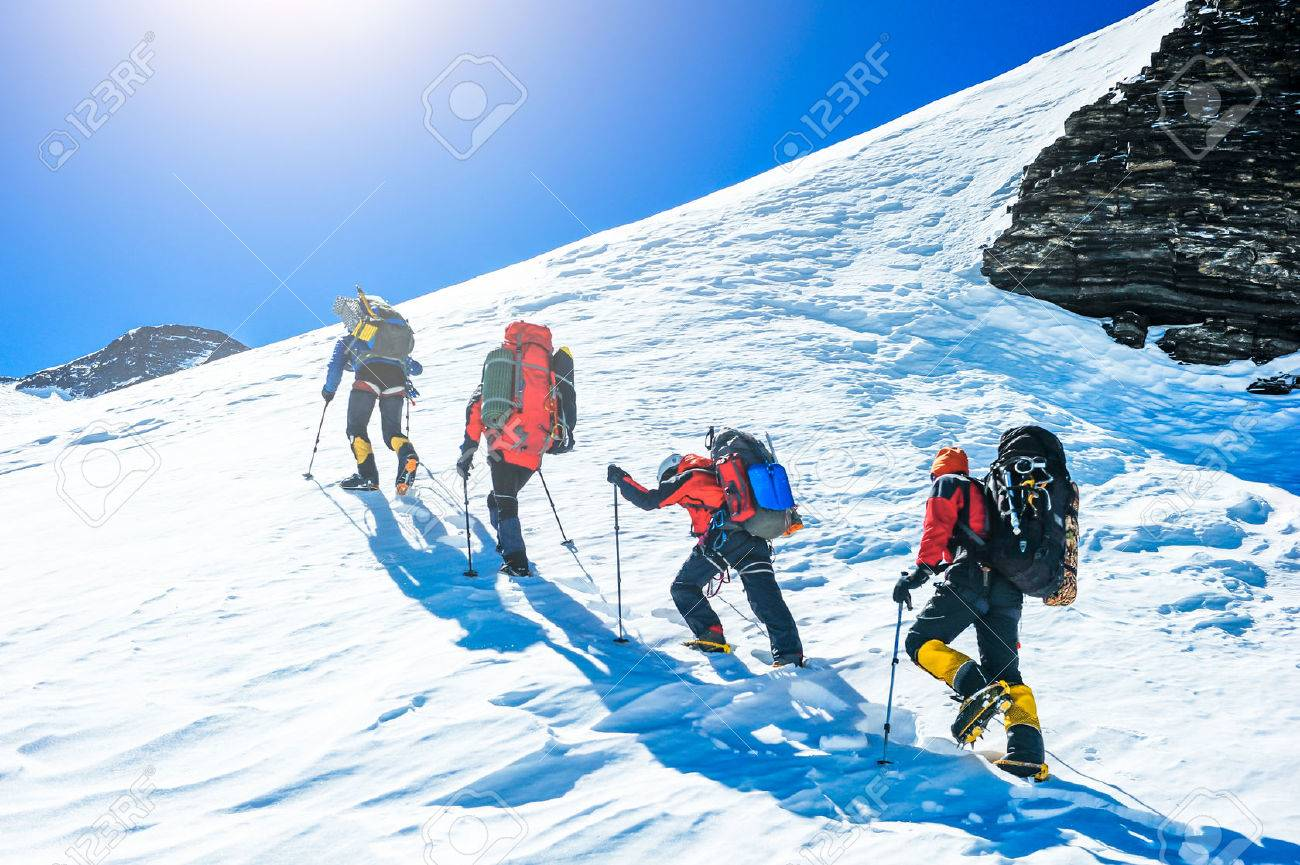 Group of climbers reaching the summit. Extreme sport - 53749863