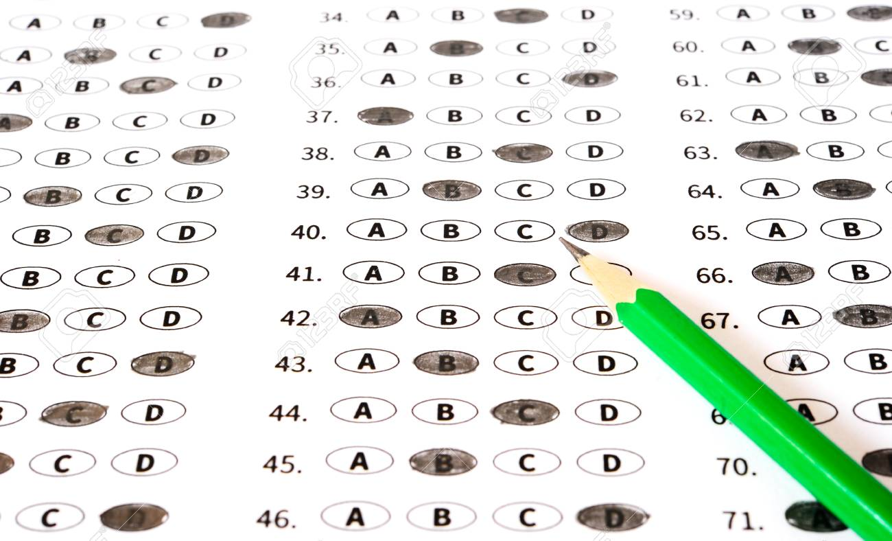 Test answer sheet with pencil  Examination test  Education concept