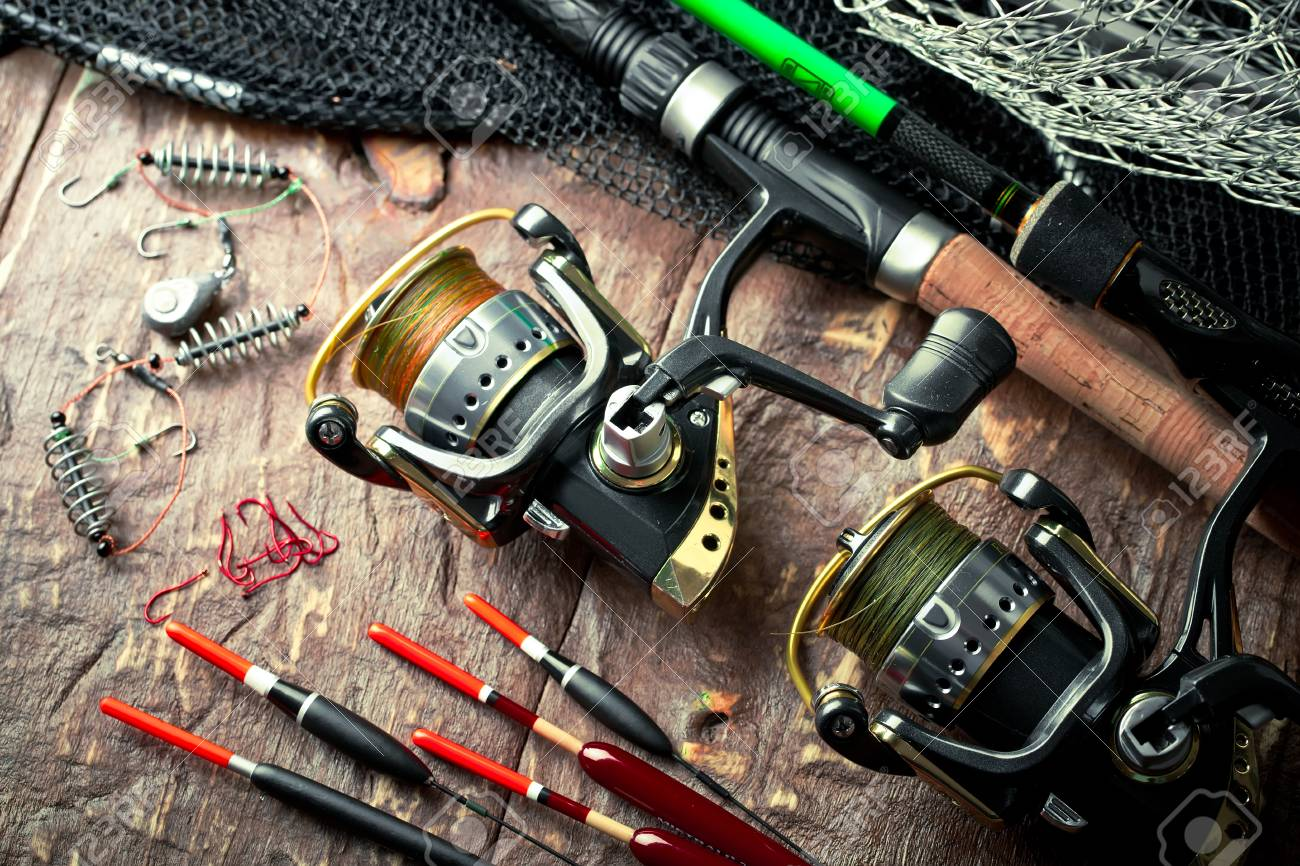 Fishing Accessories In The Composition On The Table Stock Photo, Picture  And Royalty Free Image. Image 92231993.