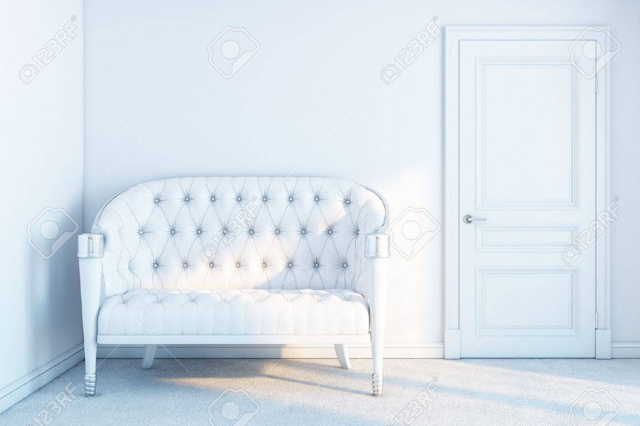 white leather sofa in a white empty room with sunrays Stock Photo - 13883236