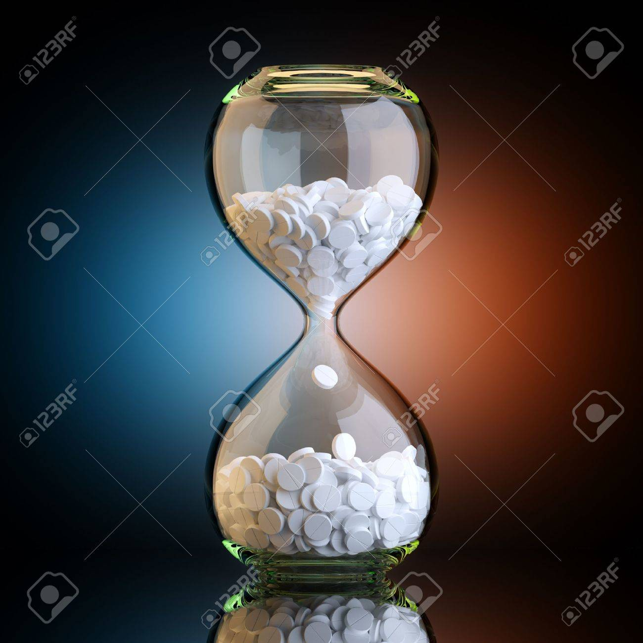 Sand Clock With Pills In Black Studio With Artistic Backlight - 18690749
