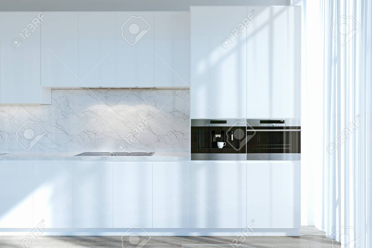 White Contemporary Kitchen Cabinets In Room With Big Windows.. Stock ...