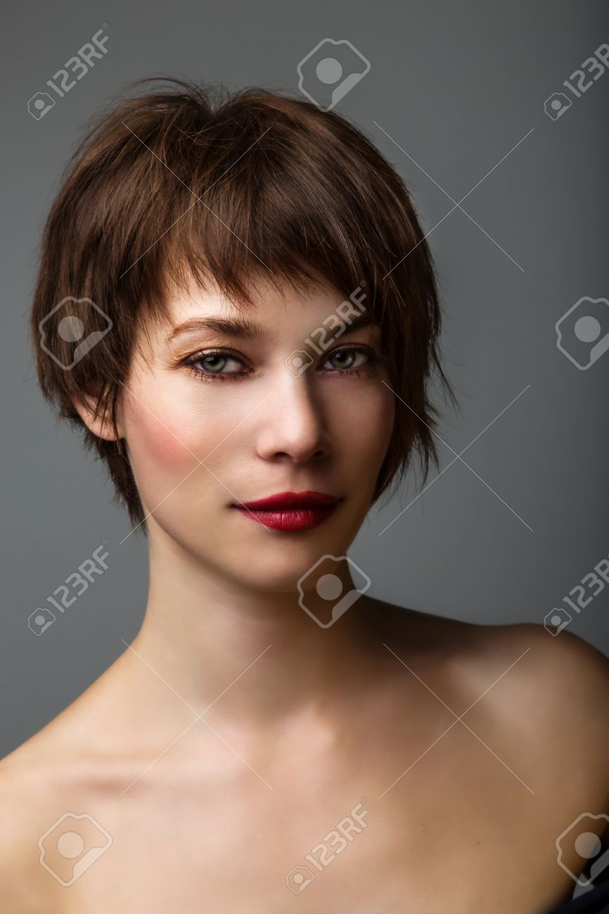Side Portrait Of A Young Woman With Short Brown Hair And Brown