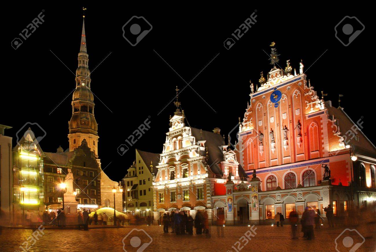 Riga, the town hall area, Sacred Peter's church and the house Black-headed at night. - 4030743