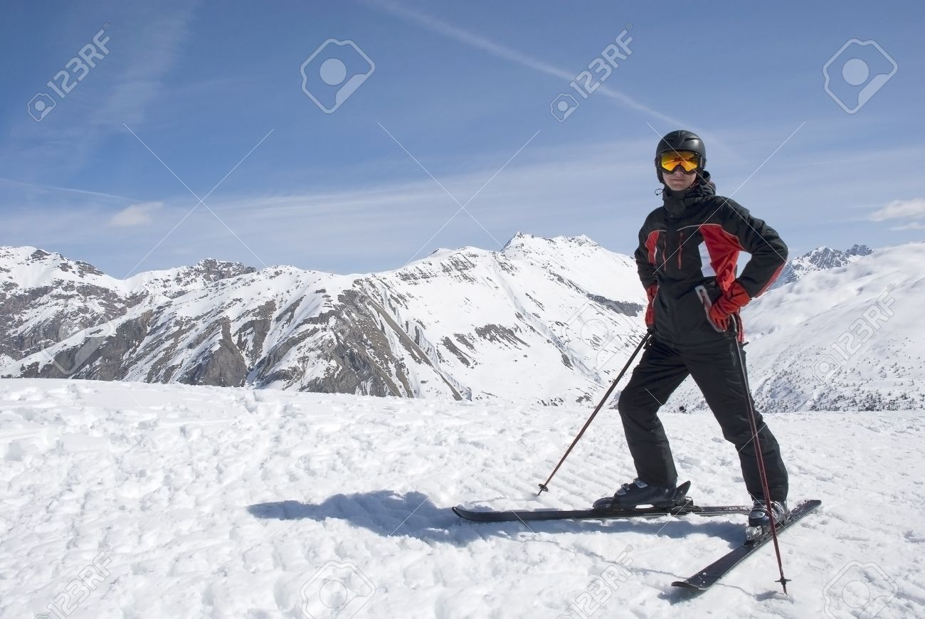 The Man In The Mountain-skiing Form In A Helmet And Glasses ...