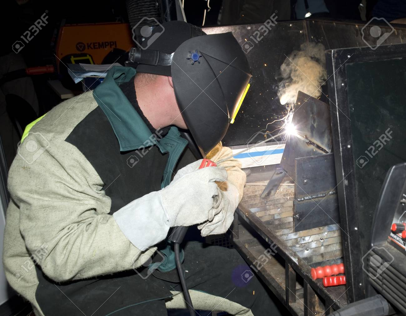 The welder in the protective form in operation runtime - 10897406