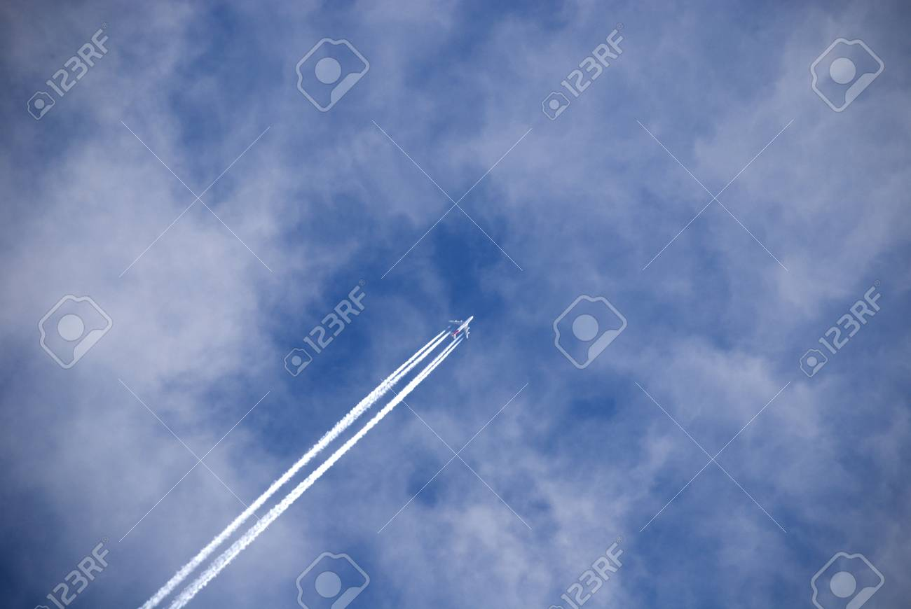 Flight of the passenger plane against white clouds. - 50015297