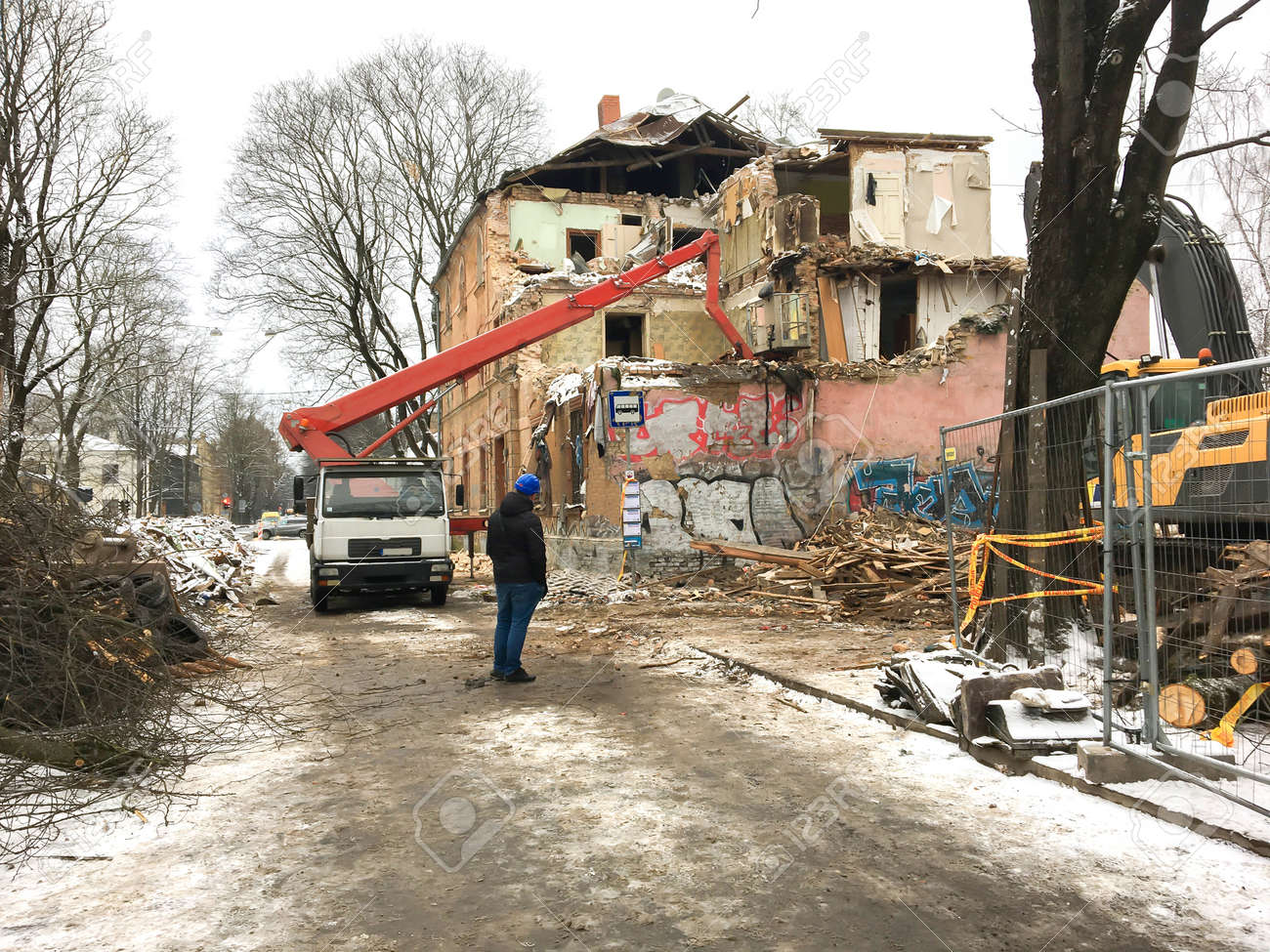 Demolition of an old, dilapidated residential building on a city street - 163526000