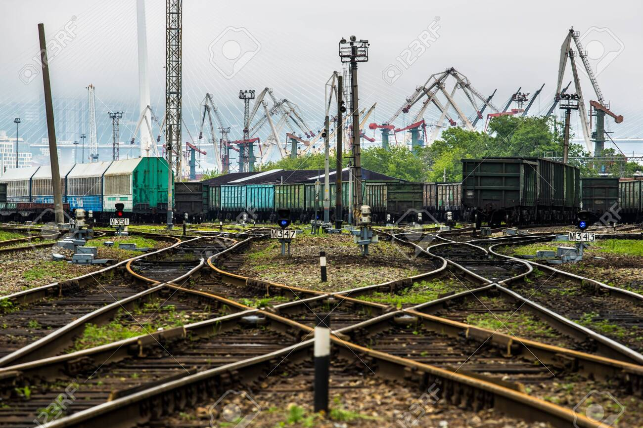 Railway tracks and the port in the background - 121625321