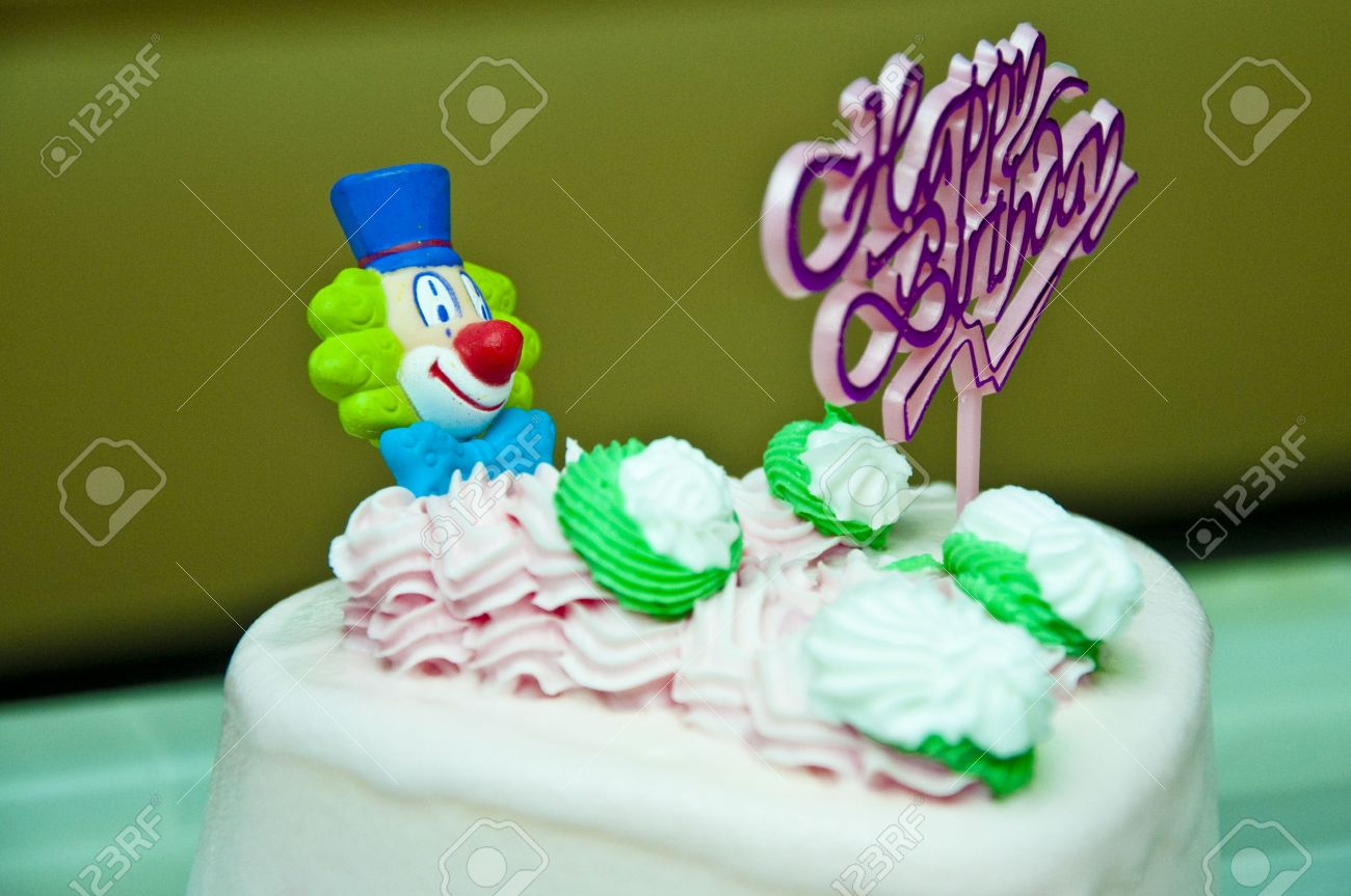 Heartshaped Birthday Cake With A Clown And Happy Sign On It Stock Photo