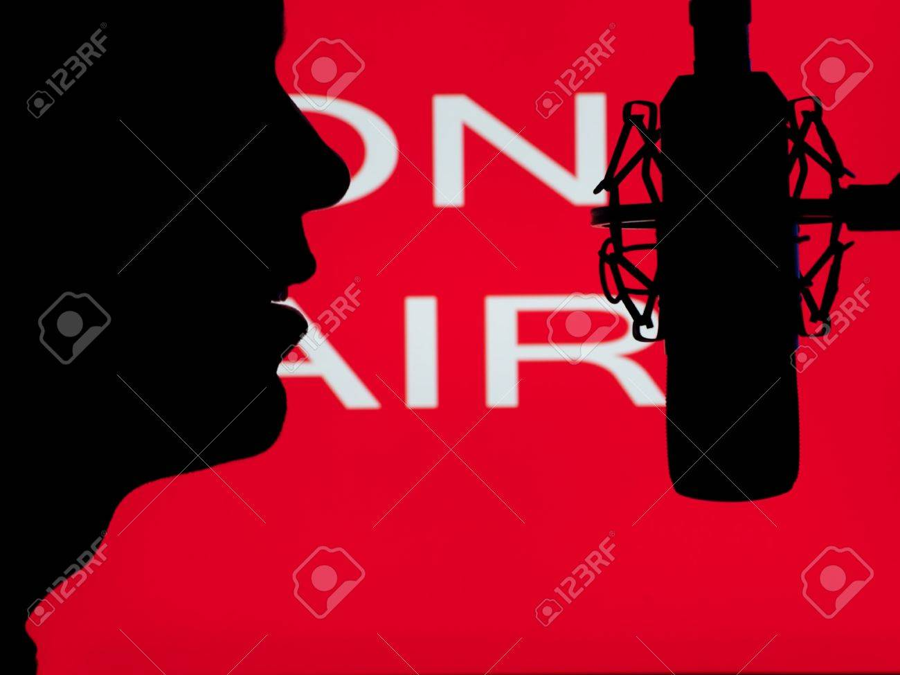 man speaking into the microphone with on the air sign in the background,for entertainment,broadcasting,sound themes Stock Photo - 9361481