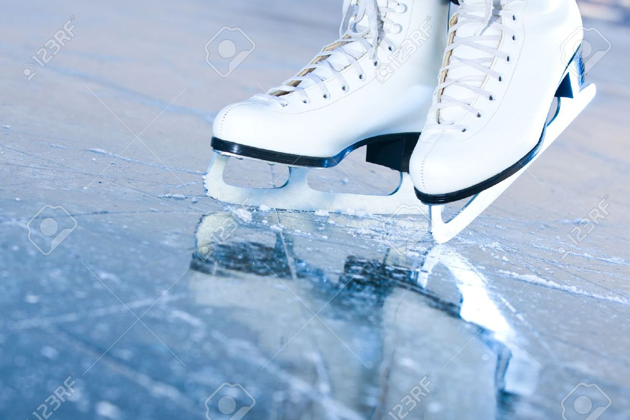 Tilted blue version, ice skates with reflection Stock Photo - 12525130