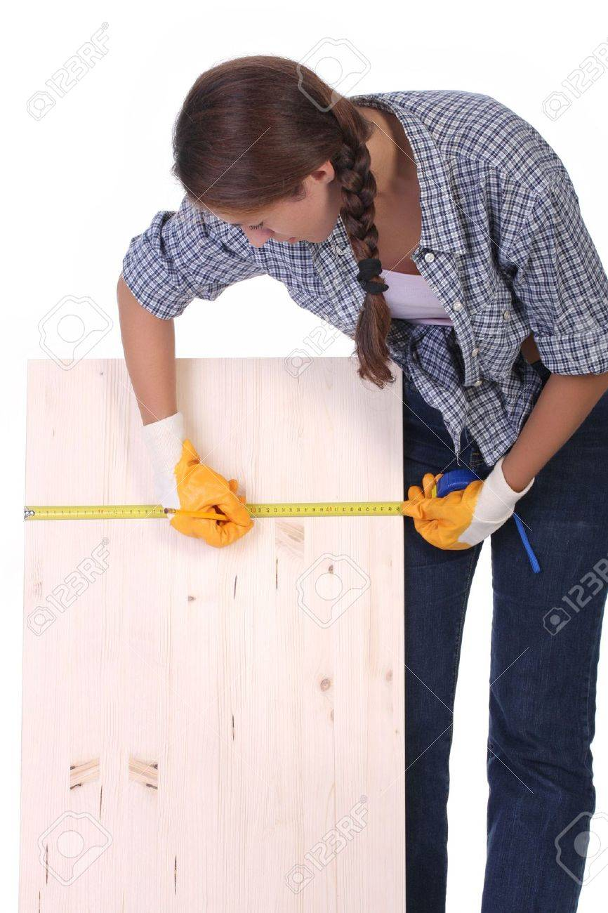 woman carpenter with wooden plank and measuring tape Stock Photo - 3467216