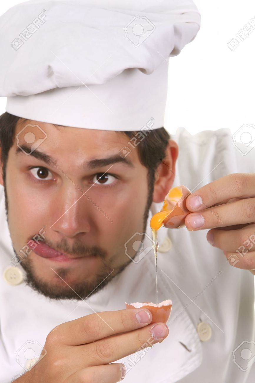 young funny chef cracking an egg, focus on egg Stock Photo - 3834266