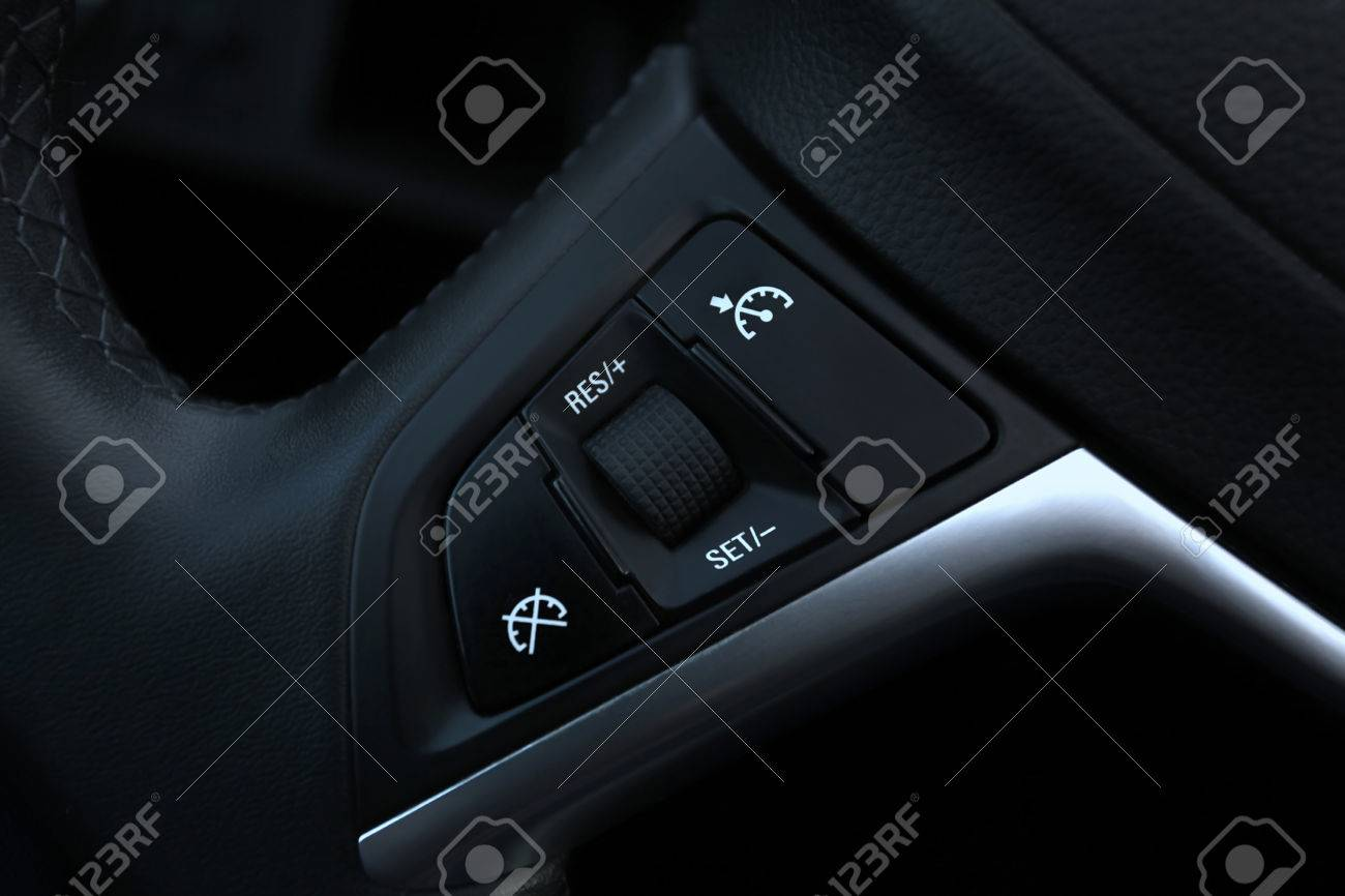 speed limitation and cruise control buttons on a steering wheel