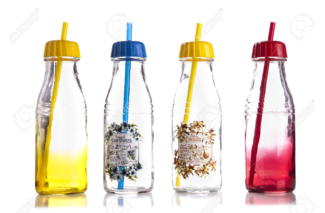 empty colored glass bottles with a lid and a straw on white backgroundjuice bottles - Colored Glass Bottles