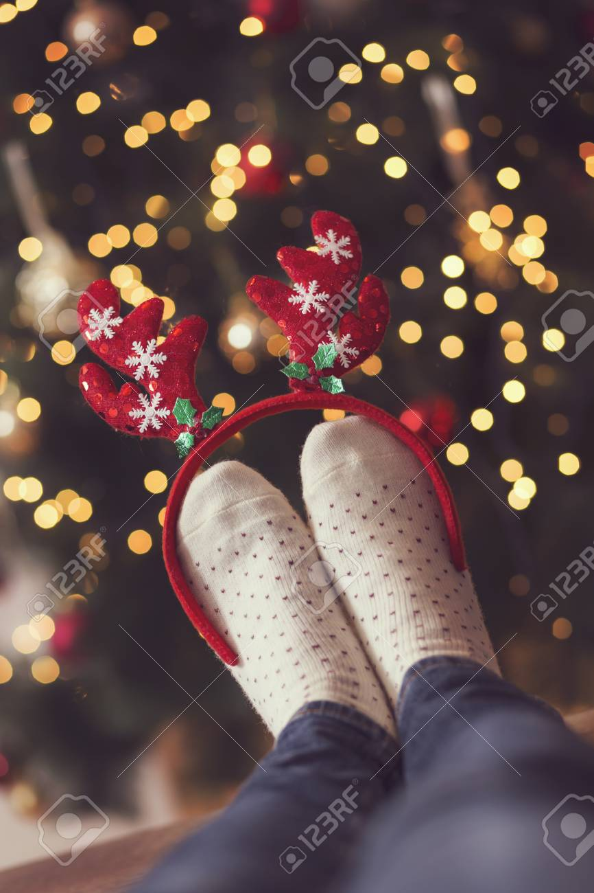 537641d3eb0 Detail Of Woman s Feet Wearing Warm Winter Socks And Small Antlers ...