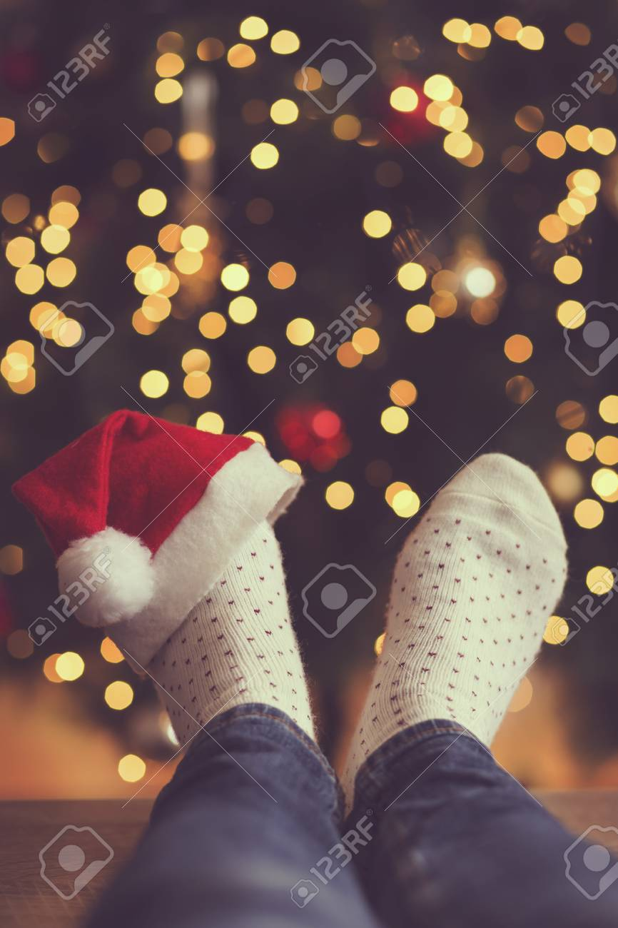 9fa2474530a Detail Of Woman s Feet Wearing Warm Winter Socks And Small Santa s ...