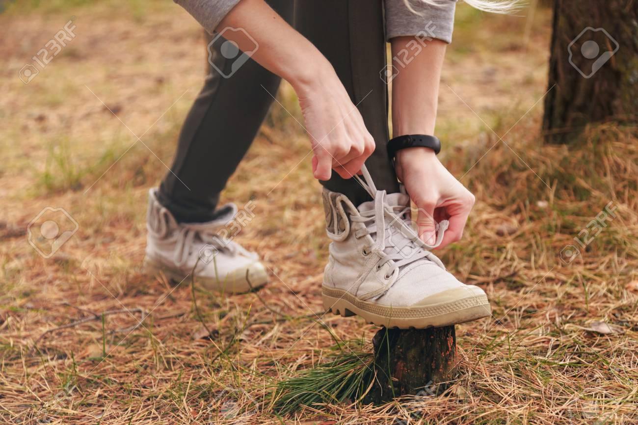 Hiking Shoes - Woman Tying Shoe Laces