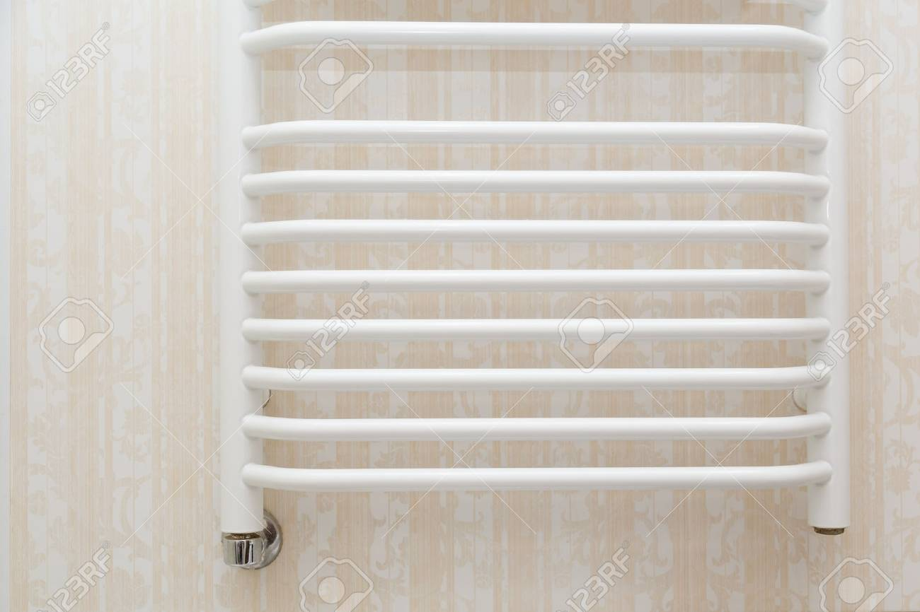 Wall Hung White Towel Rail Radiator On Travertine Tiles In Modern ...