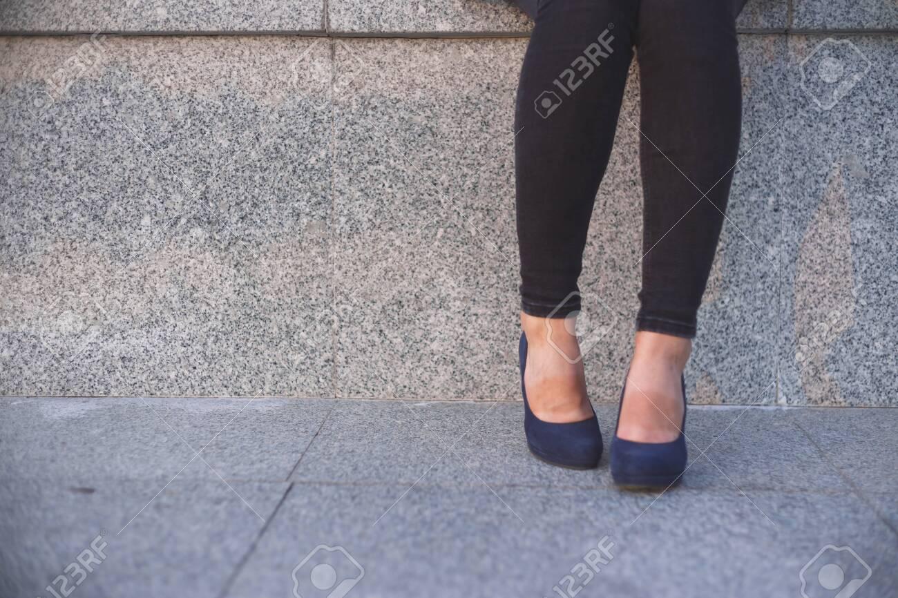 Wom?n in high heels having a rest. - 129465478