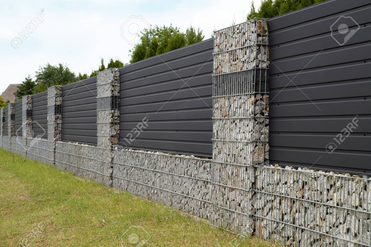 A modern form of house fencing gabions steel galvanized nets filled with split stone