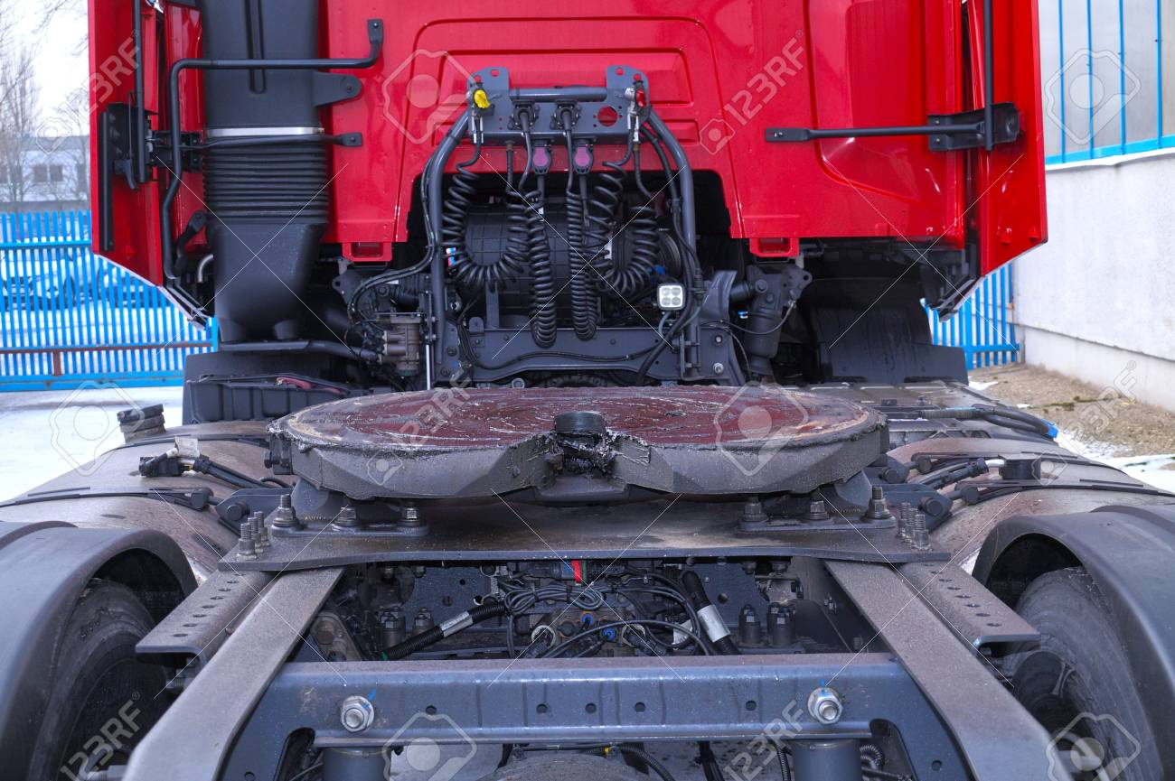 View of the back part of the 18 wheeled truck. Visible fifth wheel couplings are fitted to a tractor unit to connect it to the trailer. - 117265629