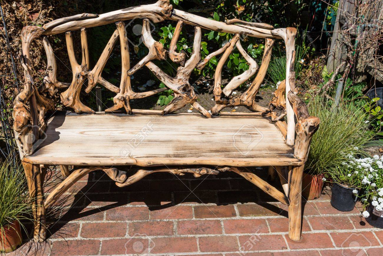 Rustic Wooden Bench In Garden Stock Photo Picture And Royalty Free Image Image 18665846