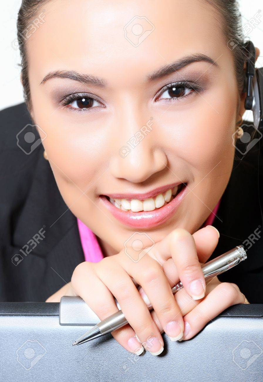 Portrait of young girl with the opened smile, pinning against an ear hands-free device, with optimism looking forward. Look other photos of this series: Stock Photo - 4241823