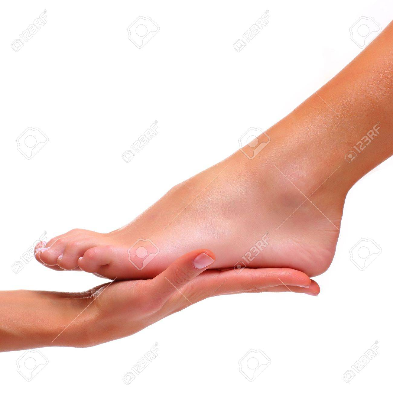 Foot of a female foot lays on a palm Stock Photo - 4681337