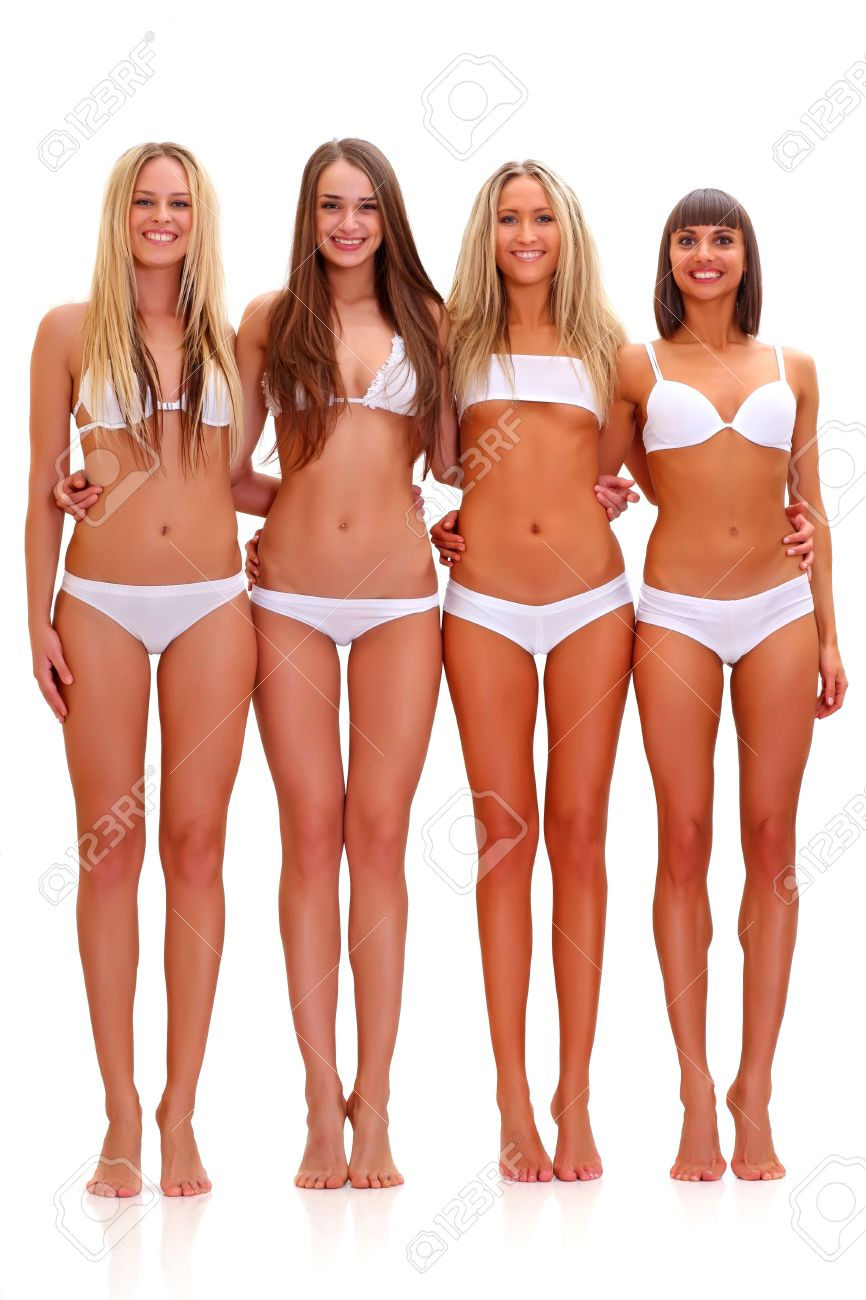 Three Harmonous Suntanned Young Women In Full Growth, In White ...