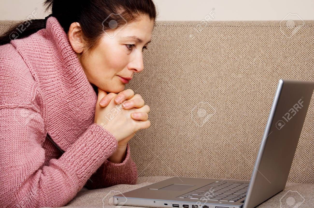 Senior woman with laptop, relaxing on the couch Stock Photo - 19164262