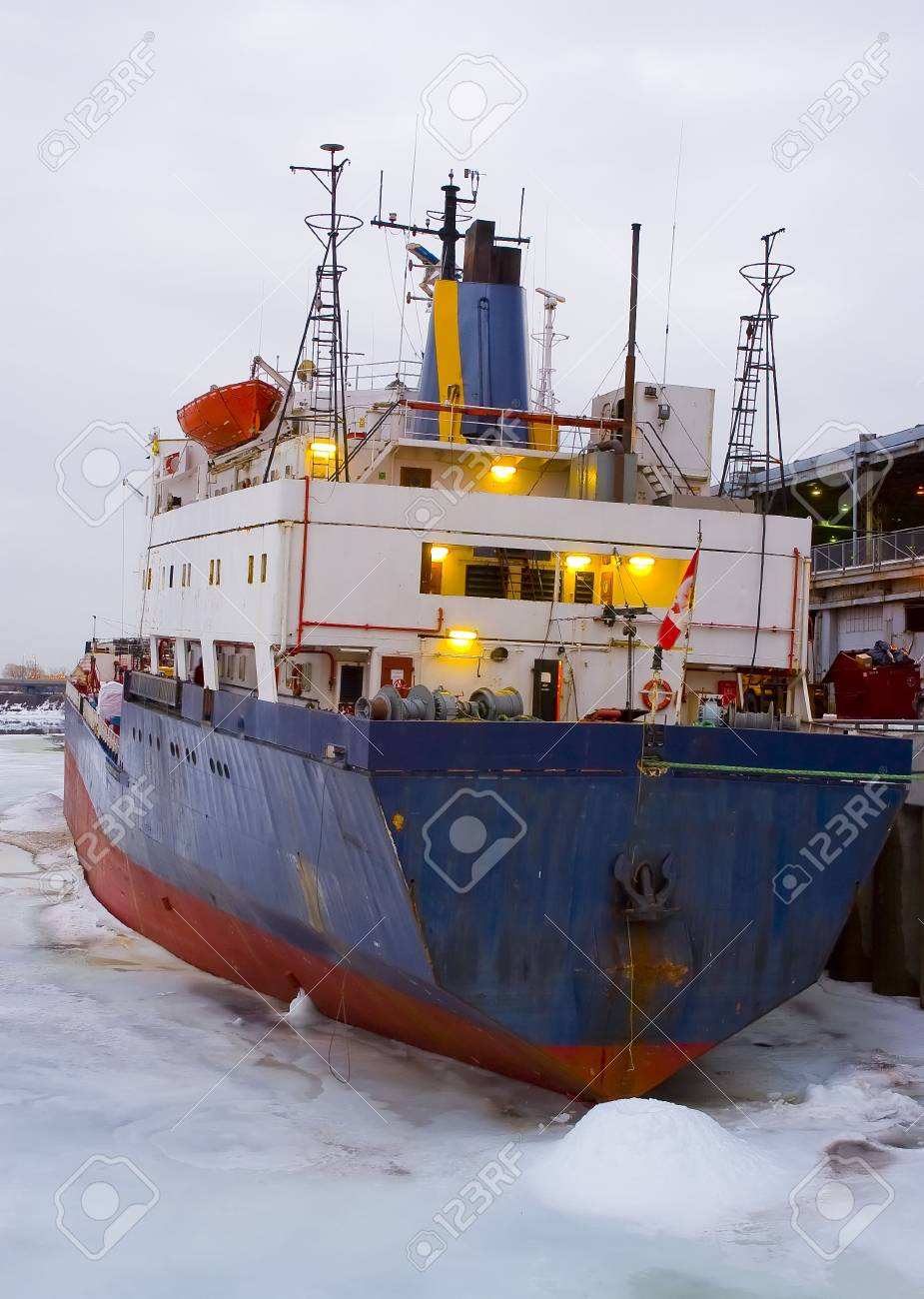 a rusty cargo ship prisoner of ice
