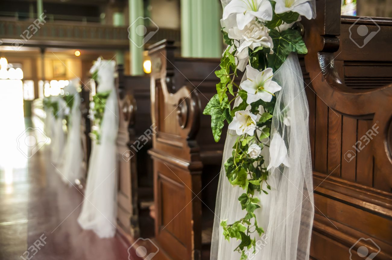 Wedding decoration white flowers and green leafs hanging on the imagens wedding decoration white flowers and green leafs hanging on the church benches junglespirit Gallery