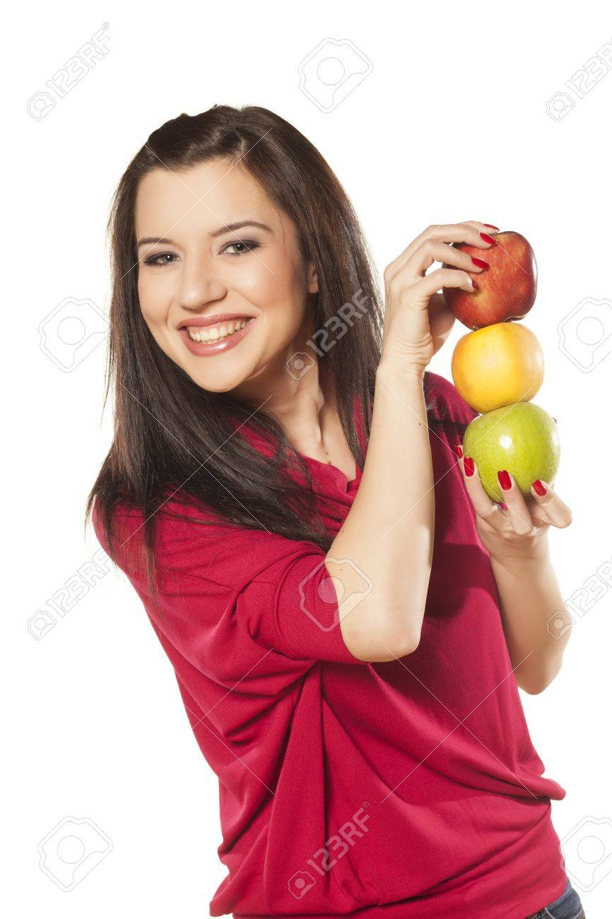 smiling beautiful dark-haired girl with blue eyes shows three different apples Stock Photo - 19350202