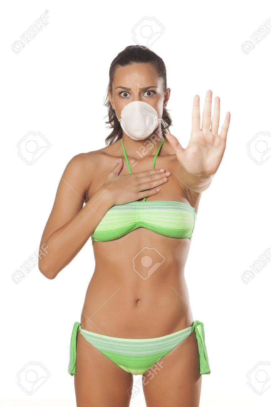 beautiful brunette with a breathing mask in a bikini showing stop sign with her hand Stock Photo - 22701785
