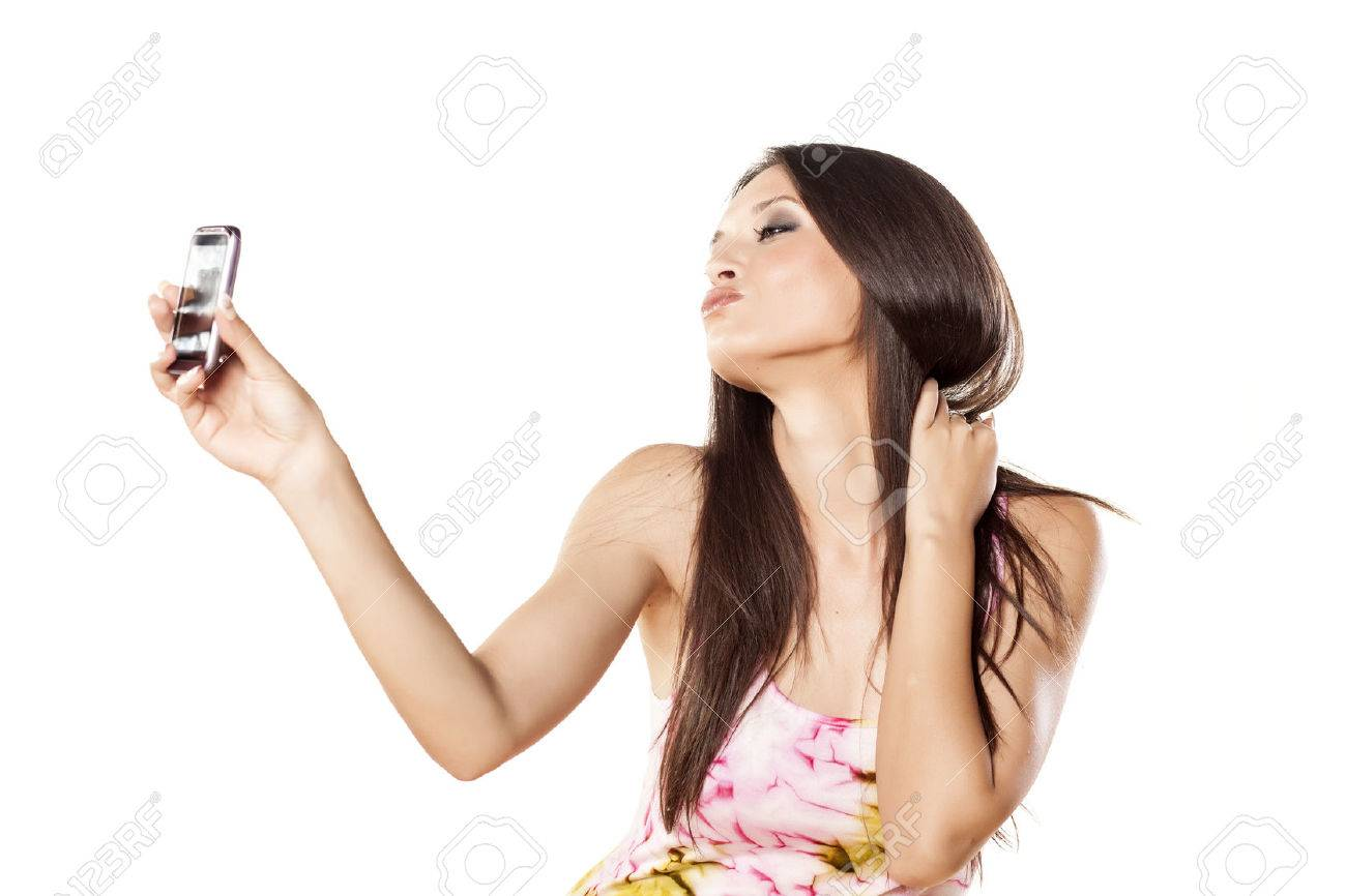 nice girl make a self portrait with her smartphone and make a