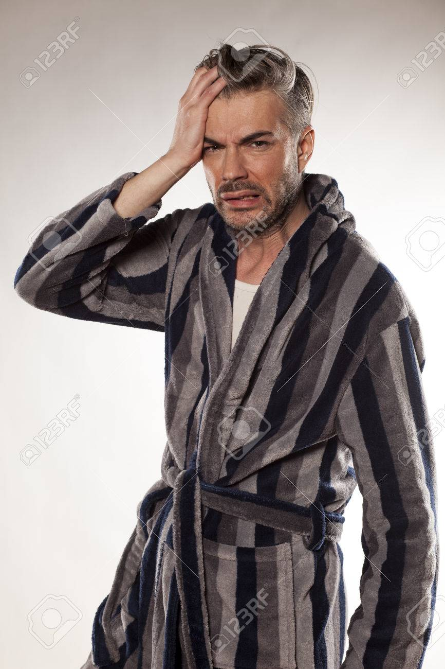 Handsome Hungover Man In A Striped Bathrobe Stock Photo Picture And Royalty Free Image Image 57077062