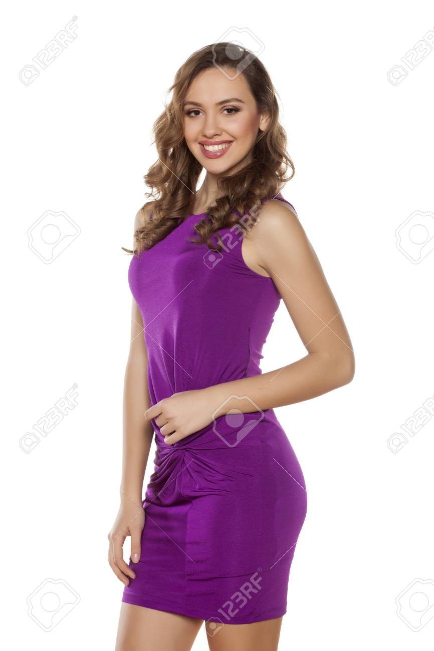 Beautiful Young Woman Posing In A Violet Tight Short Dress Fotos ...