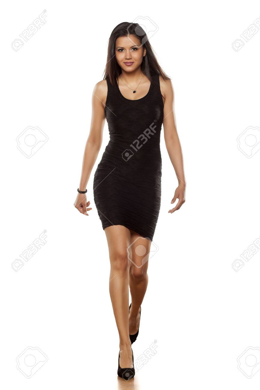 970d58a178d30 Young Beautiful Lady Walking In Short Black Tight Dress Stock Photo ...