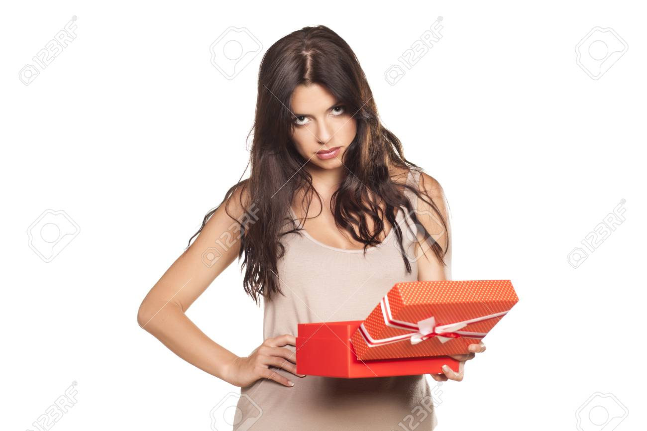 pretty girl is not satisfied with her gift - 65620630