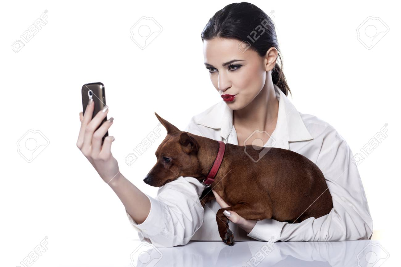 girl and dog make themselves self portrait by phone stock photo