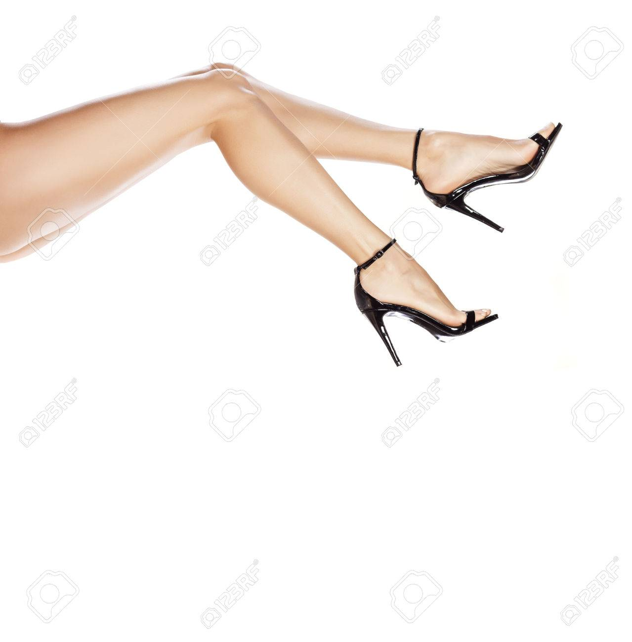 8ca4df765bfdb7 pretty female legs in elegant sandals with high heels Stock Photo - 70117983
