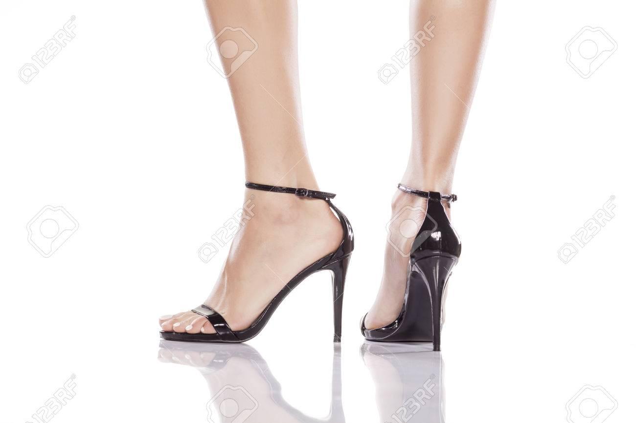 e719b676415a5c pretty female legs in elegant sandals with high heels Stock Photo - 70117991