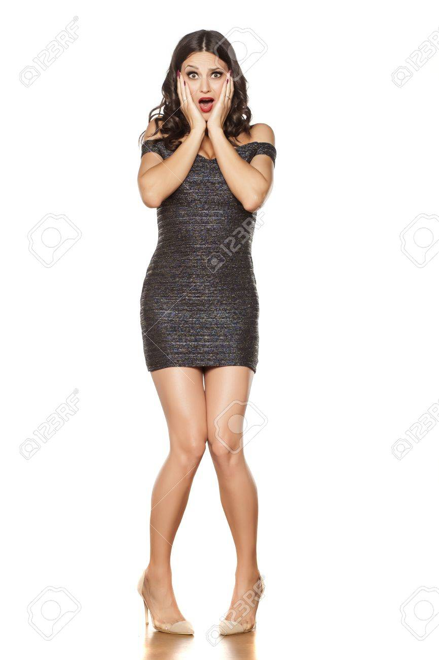 dbd5a063a0cd shocked young beautiful woman in elegant short dress and high heels Stock  Photo - 70234530