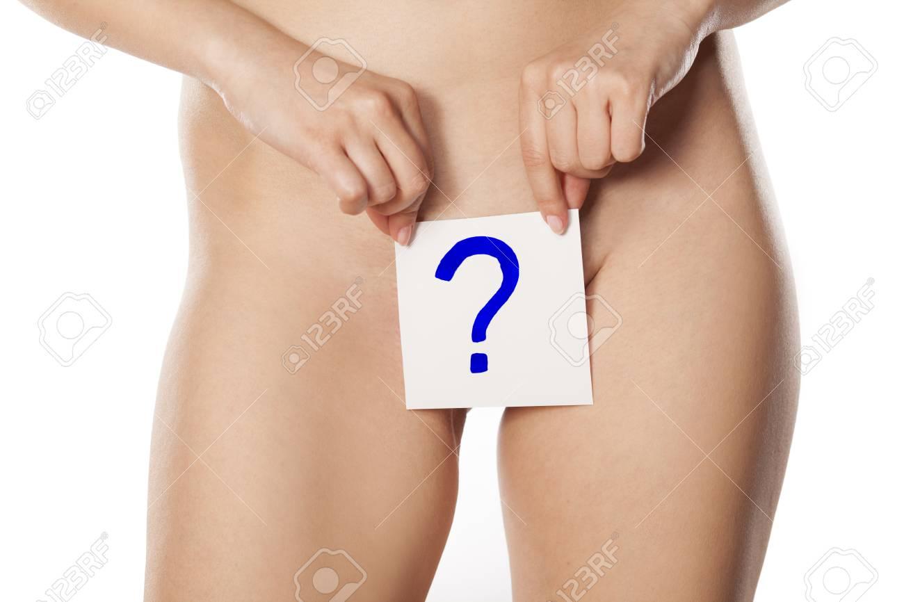 Girl holding her vagina