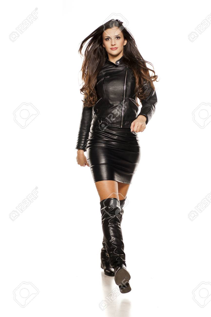 arriva immagini dettagliate acquisto autentico Young Beautiful Woman Walking In Leather Jacket, Boots And Skirt ...