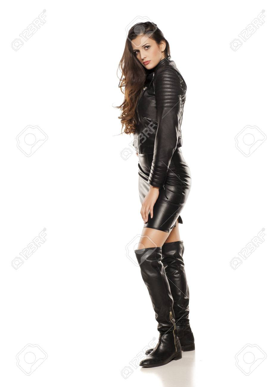acquisto genuino l'ultimo negozio del Regno Unito Young Beautiful Woman In Leather Jacket, Boots And Skirt Stock ...